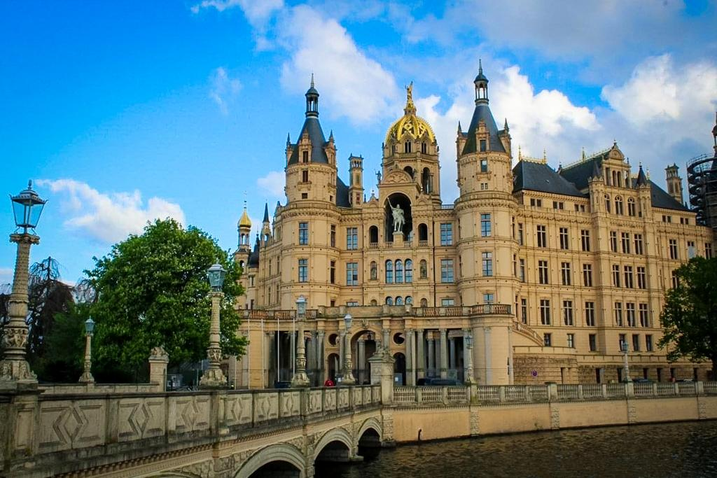 The view of the Schwerin Castle from the lake and bridge over the lake.