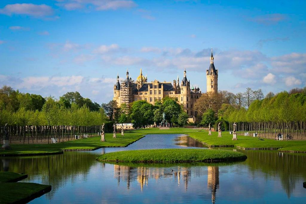 Schwerin Castle on The lake Schwerin surrounded by gardens and statues of the castle